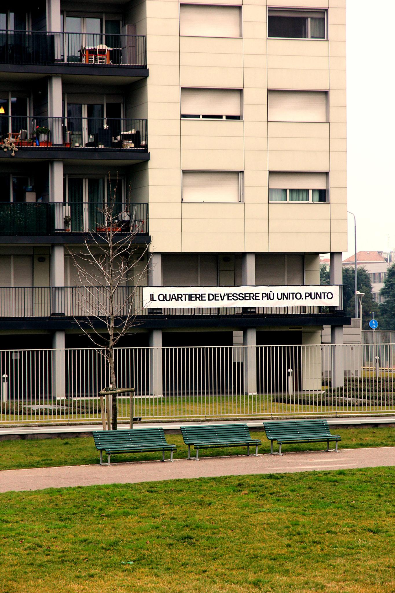 Periferia nord est di Milano, al centro del progetto di arte pubblica Adriano A Cielo Aperto: 47 balconi del quartiere espongono le voci degli abitanti